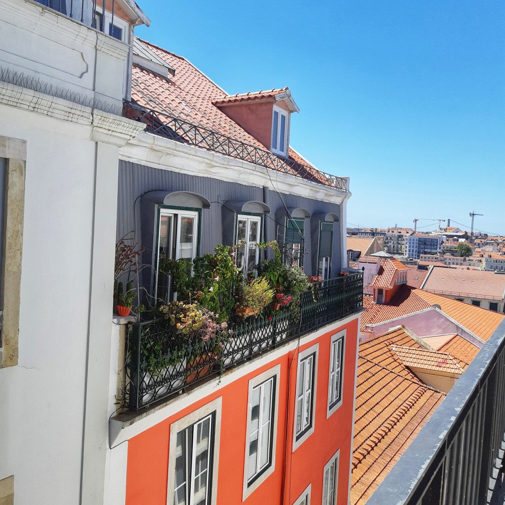 Colourful buildings in Portugal show Why you should add Portugal to your 2019 bucket list by coffee and a view